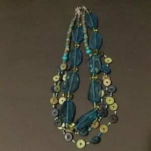 Two blue and green necklaces.